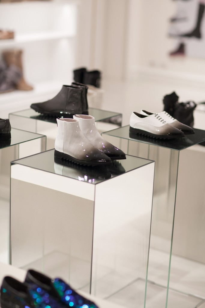 AGL: AGL design sisters Vera, Sara and Marianna Giusti channelled a swingy Sixties London vibe with these ombré white to black patent booties.