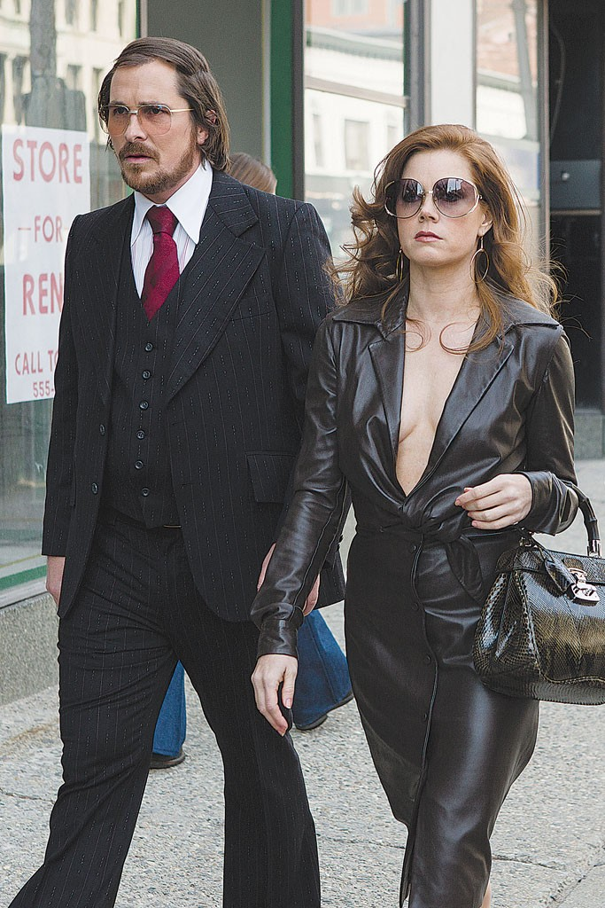 """Christian Bale, Amy Adams and Bradley Cooper don retro Seventies styles in """"American Hustle."""""""