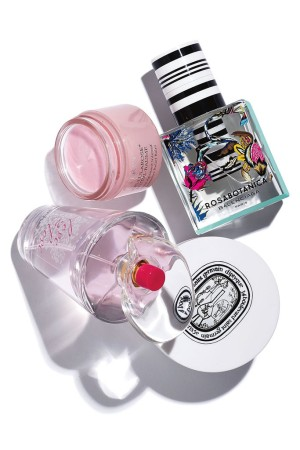Clockwise from top: Balenciaga Rosabotanica; Diptyque Nourishing Cleansing Balm for the Face; Love2Love Fresh Rose + Peach Eau de Toilette; By Terry Cellularose Nutri-Baume Intensive Relief Balm