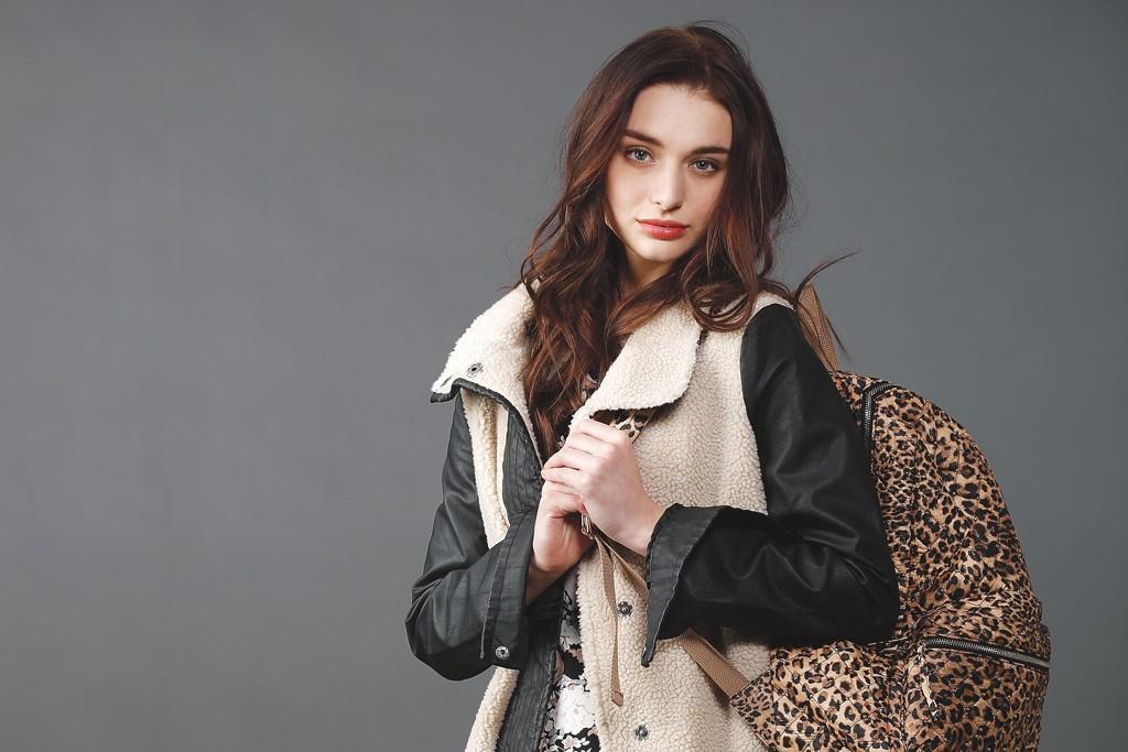 WWDMAGIC: Coffeeshop's polyester fleece and fake leather coat and BB Dakota's polyester dress. Nila Anthony backpack; Leg Avenue hosiery.