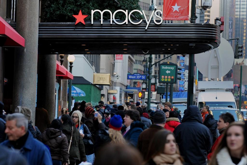 Pedestrians walk past Macy's flagship store in New York.