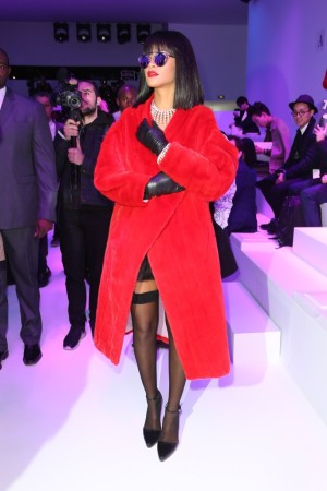 At Dior: Draped in pearls and a red mink coat from Dior's fall 2013 couture collection, Rihanna oozes old Hollywood glamour.