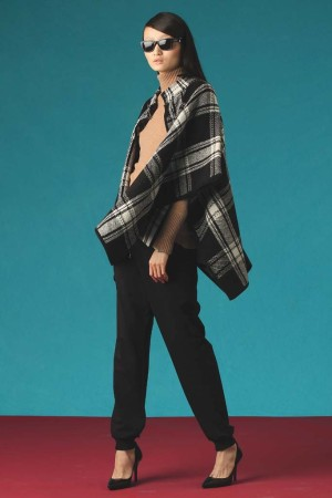 Lauren Ralph Lauren's lamb's wool and nylon cape; Kinross' cashmere sweater, and Jones New York's cotton, viscose and elastane pants. Anne Klein sunglasses; Lauren Ralph Lauren shoes.