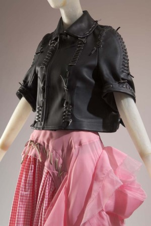 """A look from the """"Beyond Rebellion: Fashioning the Biker Jacket"""" exhibit."""
