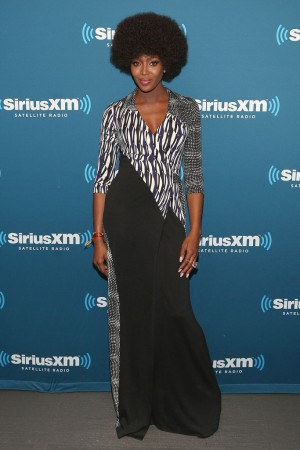At SiriusXM's Town Hall discussion with Diane von Furstenberg, Naomi Campbell went retro glam in an asymmetrically cut wrap dress from the designer's pre-fall collection.