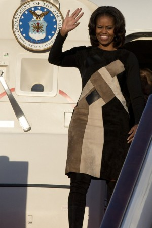 Michelle Obama in Derek Lam's wool dress with leather and suede patchwork from his fall 2013 collection.