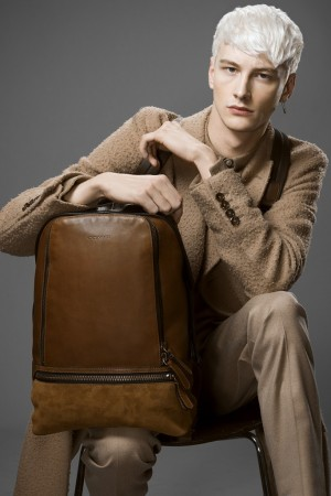 Coach backpack. Gucci's coat, Ami's shirt and Neil Barrett's pants, all in wool.