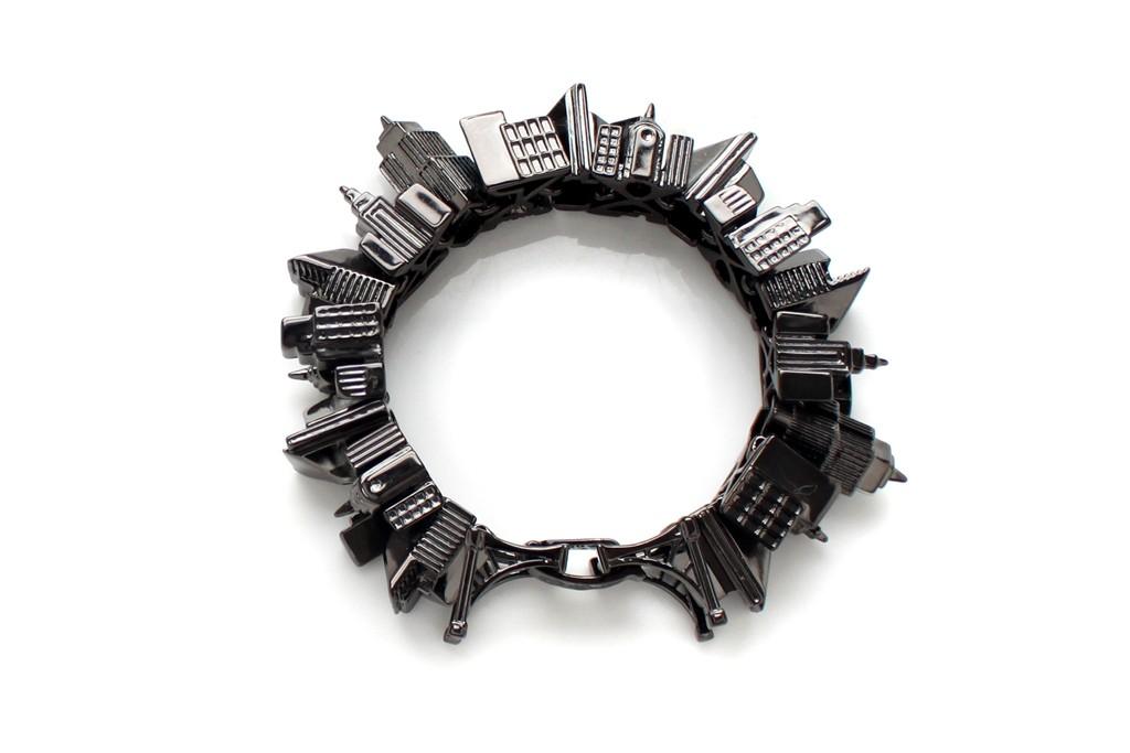 Noir's gunmetal Gotham City bracelet.