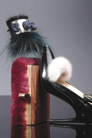 Fendi's fox fur and metal cuff with synthetic drusy stones; Nina Ricci's fox fur and wood minaudière; Eugenia Kim's mink and calfskin pump.