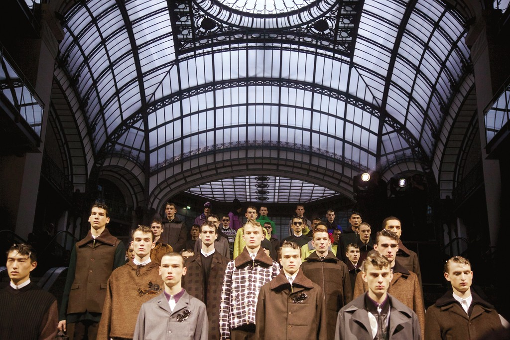 Workwear for the seriously sophisticated urban male, from the finale of Kenzo's show in the atrium of Paris' Le Centorial building. South Korean pop sensations G-Dragon and Taeyang were in attendance.