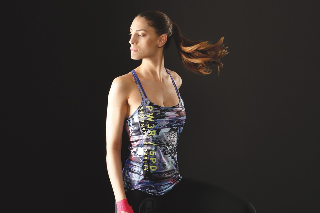 From Reebok's Training Collection, a polyester and elastane tank, polyester and spandex leggings and All-Terrain Sprint sneakers.
