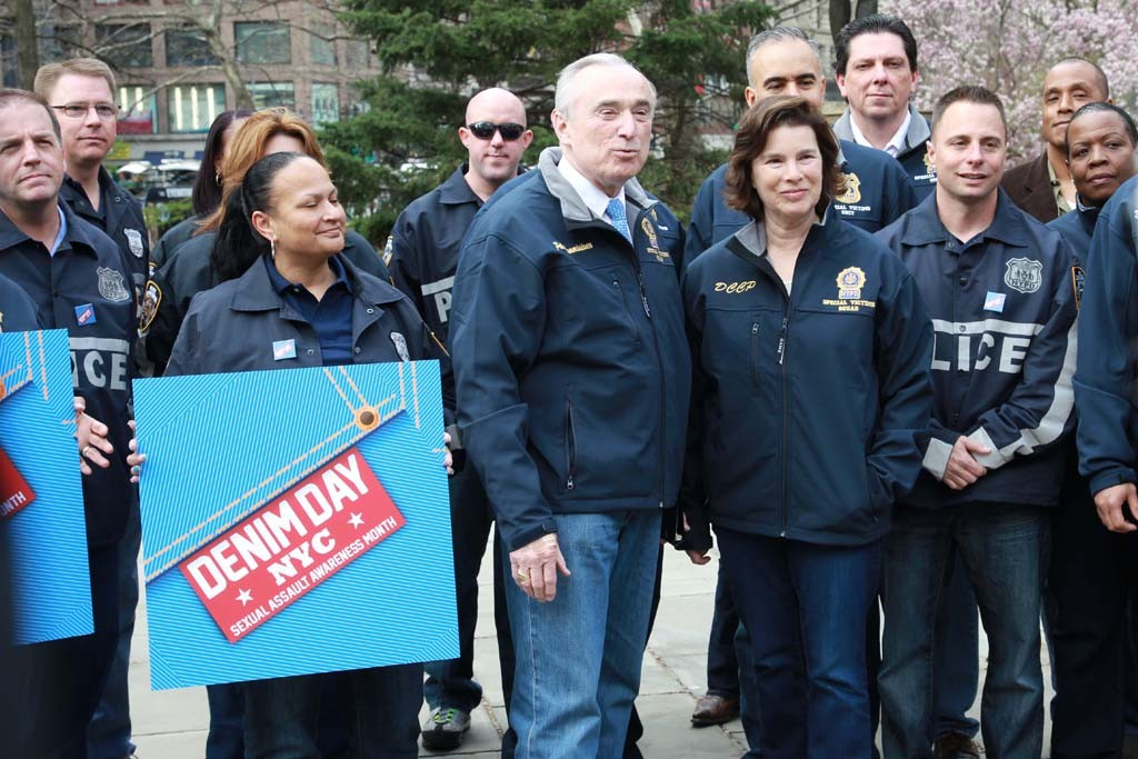 William Bratton with men and women in blue.