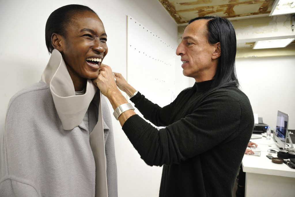 """""""A lesson on how to tie a bow with Rick Owens. The result will certainly be something that's pure and elegant. Both model and master seem to enjoy this moment, just a couple of days before the show."""""""