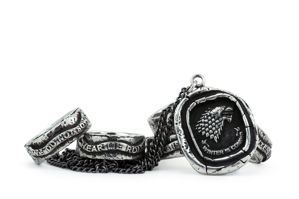 Pyrrha's House of Stark rings and necklace.