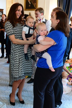 The Duchess of Cambridge in Tory Burch and Prince George meet parents and babies during a visit to Plunket.