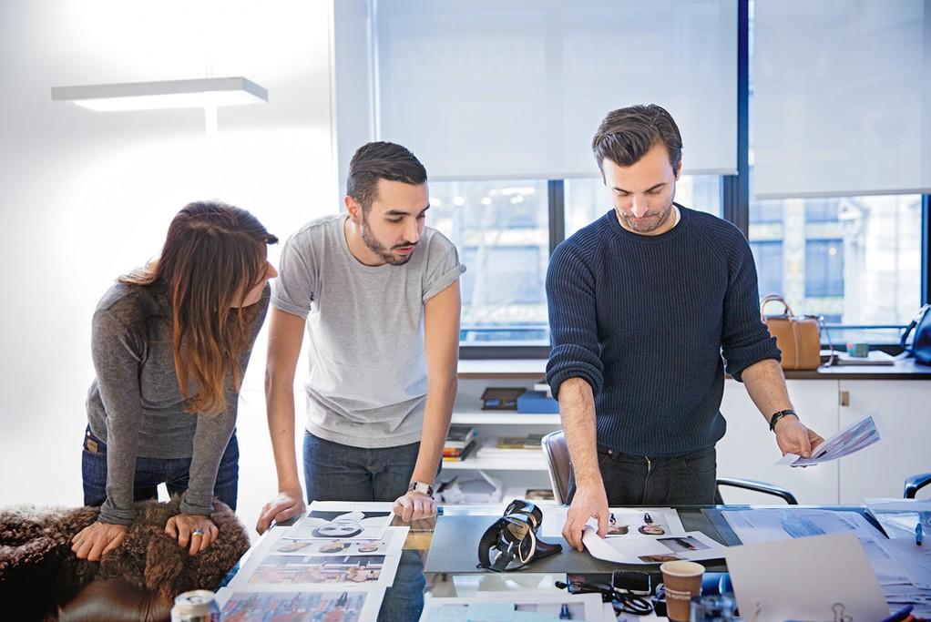 Marie-Amélie Sauvé, Florent Buonomano and Nicolas Ghesquière at work on Ghesquière's inaugural Vuitton collection.