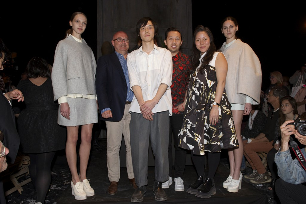 Première Vision's Philippe Pasquet, Kenta Matsushige, Humberto Leon and Carol Lim flanked by models in looks by Matsushige.