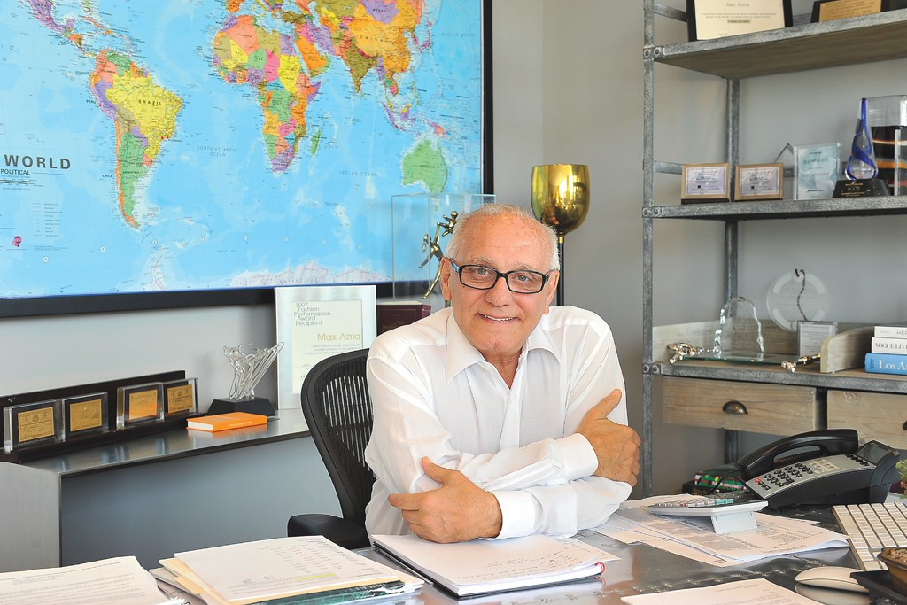Max Azria at his airplane-wing desk in the Vernon, Calif., headquarters.