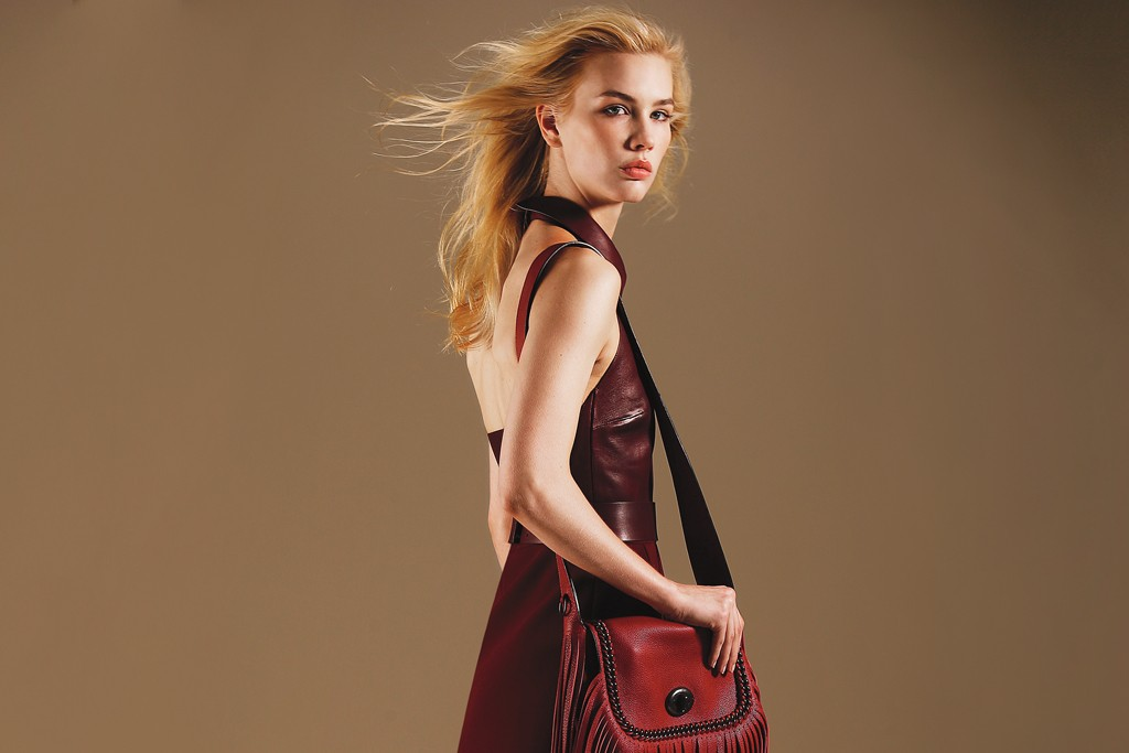 Coach's leather Whipstitch bag and Brian Atwood's suede patchwork boots shown with Gucci's dress.