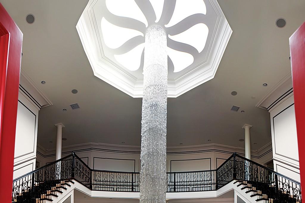 A dramatic chandelier in an atrium of La Maison de Soleil.