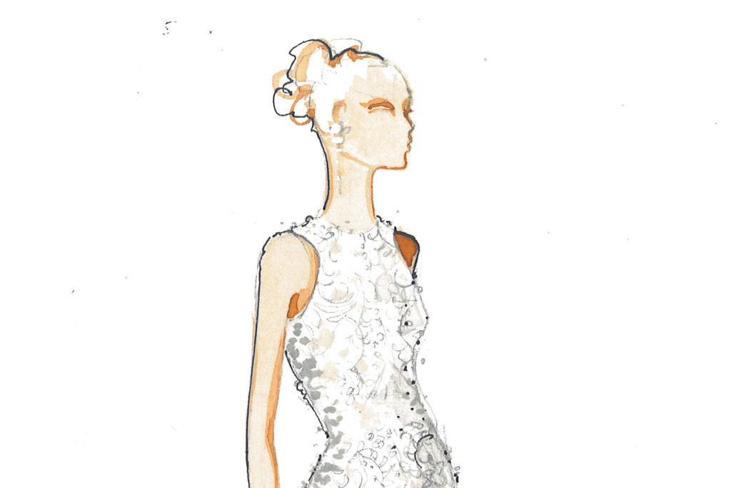 The ivory crystal beaded and embroidered Chantilly lace halter gown by Carmen Marc Valvo.