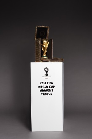 Louis Vuitton case holding the World Cup trophy.