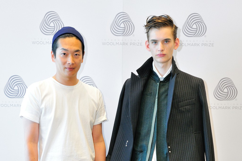 Seishin Matsui with a model in one of his looks.