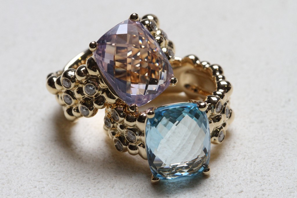 Molten rings with faceted blue topaz and amethyst.