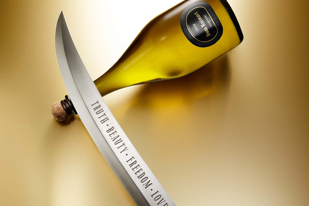 """A limited-edition handcrafted Champagne sabre engraved with the words, """"Truth. Freedom. Beauty. Love."""""""