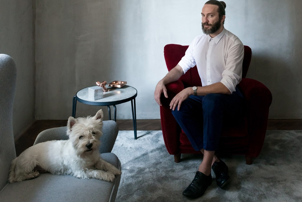 Michele Pasini, shown here in his apartment with his West Highland white terrier, Toto, has had a hand in creating a few of Milan's hot spots.