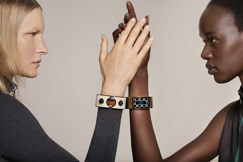 Models Kirsten Owen and Ajak Deng wearing Opening Ceremony and Intel's MICA bracelets with looks from the fall collection.
