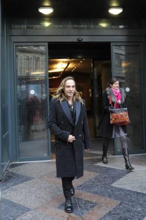 John Galliano leaving a Paris court.