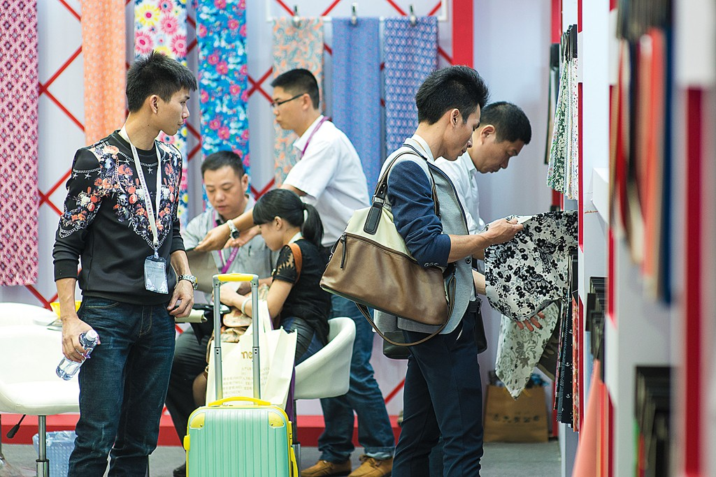 Checking out the fabrics at Intertextile Shanghai.