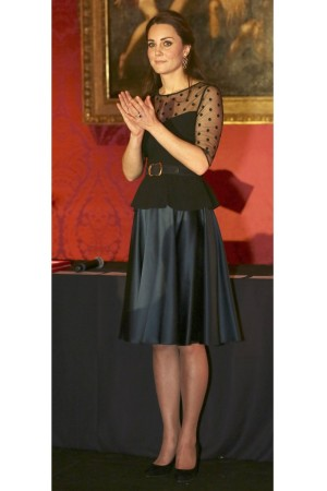 The Duchess of Cambridge in a Hobbs blouse and Jenny Packham skirt.