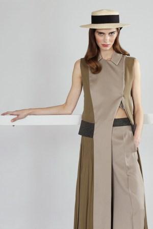 Mary Katrantzou's silk ankle-length pleated coat over cotton pants. Eugenia Kim hat.