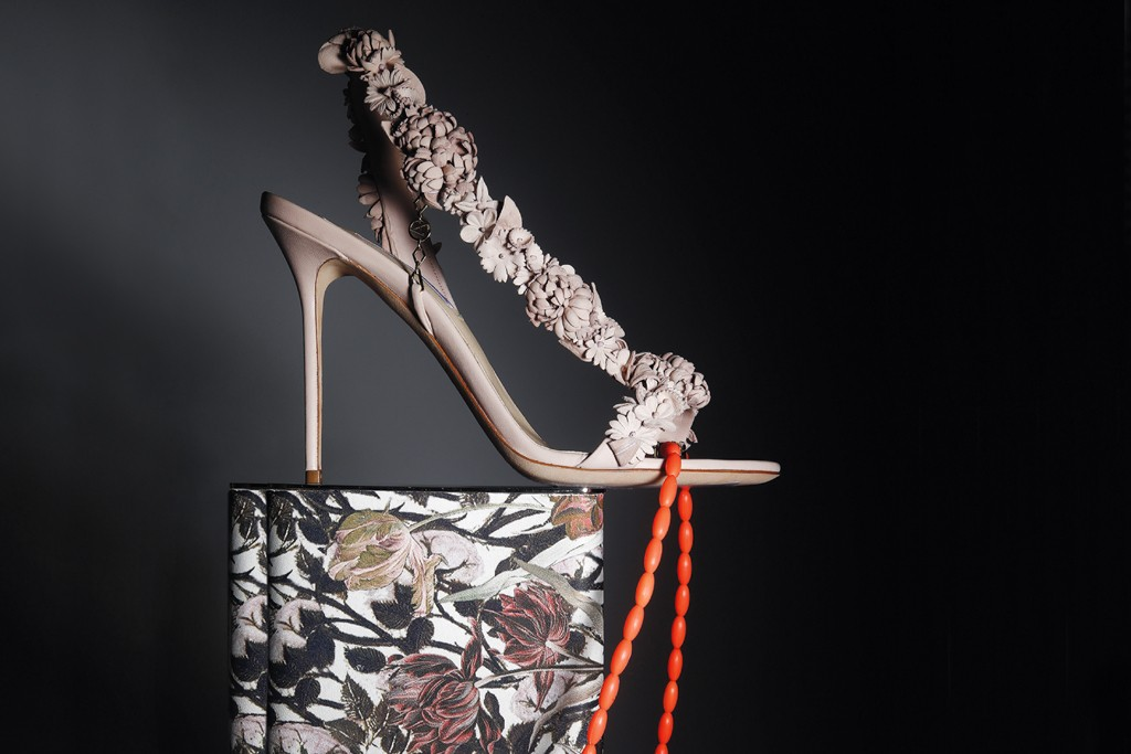 Olganna Paris by Olga Djanguirov's leather sandal with handmade flowers, Ek Thongprasert's silicone necklace and Lee Savage's brass-and-leather clutch.