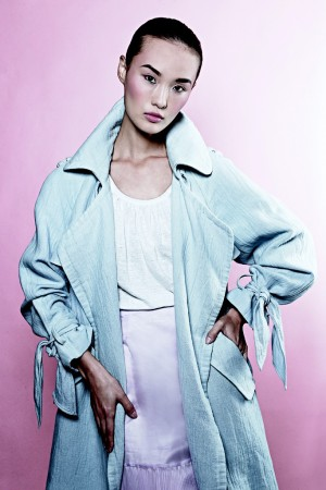 Rebecca Taylor gives the ultimate no-nonsense outerwear piece a feminine turn in powder blue, highlighting the power  of pretty. Her linen and cotton trench tops a cotton T-shirt and polyester skirt with a flirtatious pleated hem.