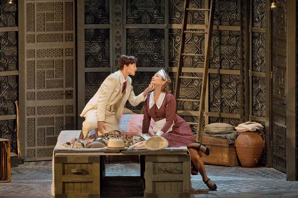 "Isabel Leonard as Cherubino and Marlis Petersen as Susanna in Mozart's ""Le Nozze di Figaro,"" with sets and costumes by Rob Howell, at the Met."
