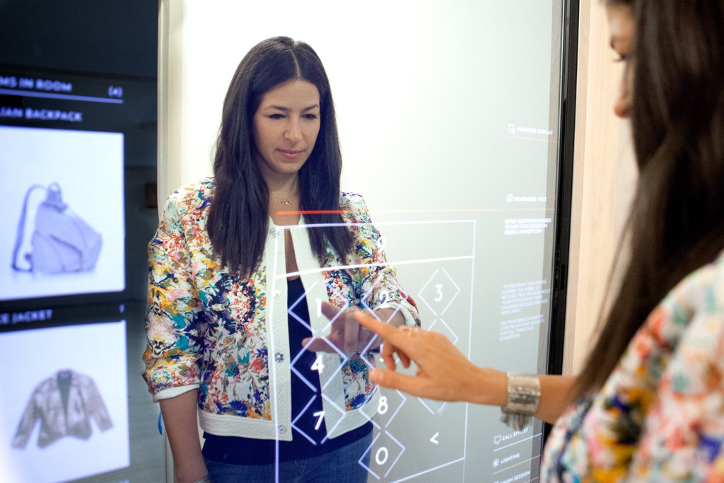 Rebecca Minkoff enters her phone number in the Connected Fitting Room at her new store, opting in to link her session to her MyRM account so she can go back and look at what she tried on at a later date.