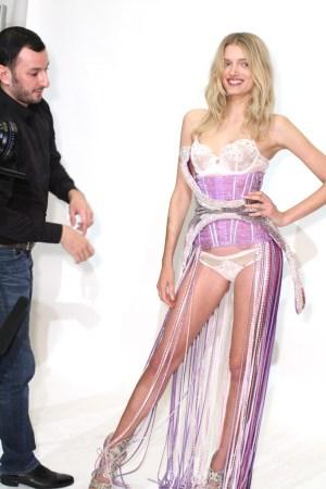 Serkan Cura fitting Lily Donaldson's Swarovski look at Victoria's Secret's Manhattan headquarters.
