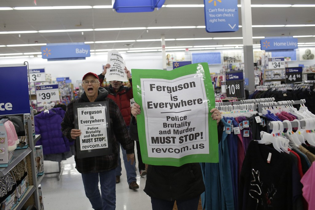 Wal-Mart workers and Black Friday boycotters converged on Friday, protesting inside stores and outside across the U.S.