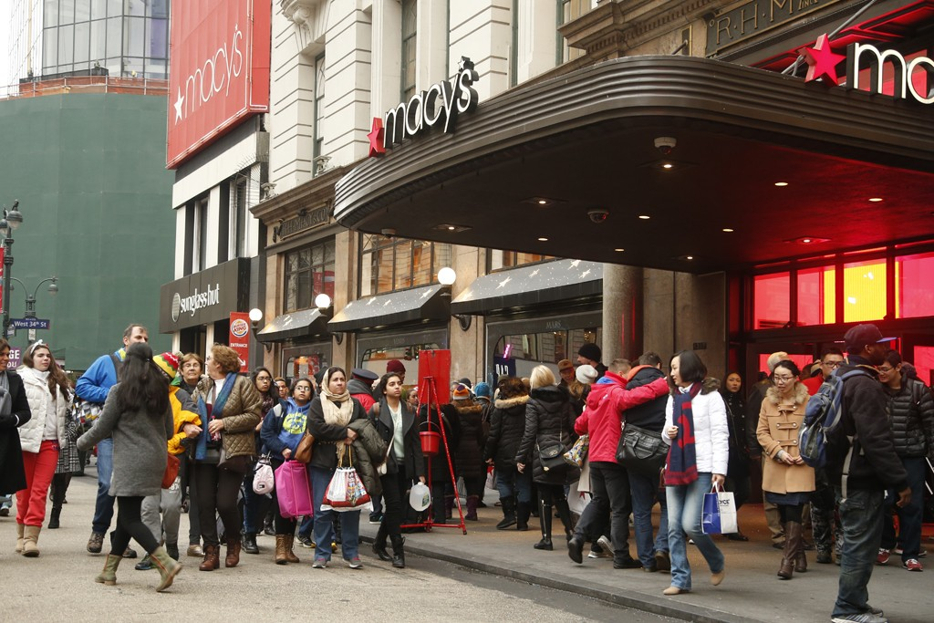 Shoppers outside Macy's in Manhattan Tuesday.