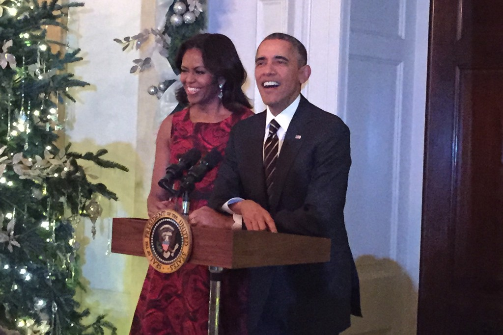 First Lady Michelle Obama, in her Talbots dress, with the President.