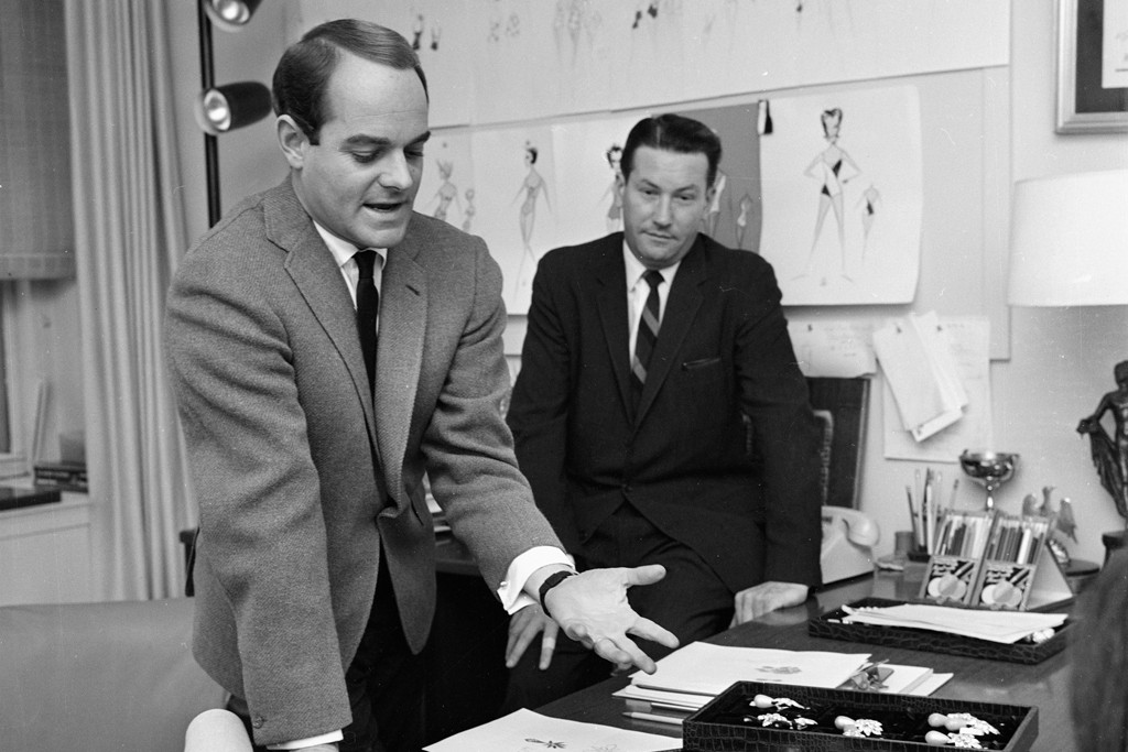 Luis Estévez with jewelry designer Robert Doell in 1963, showing his accessories collection for the House of Rodel.