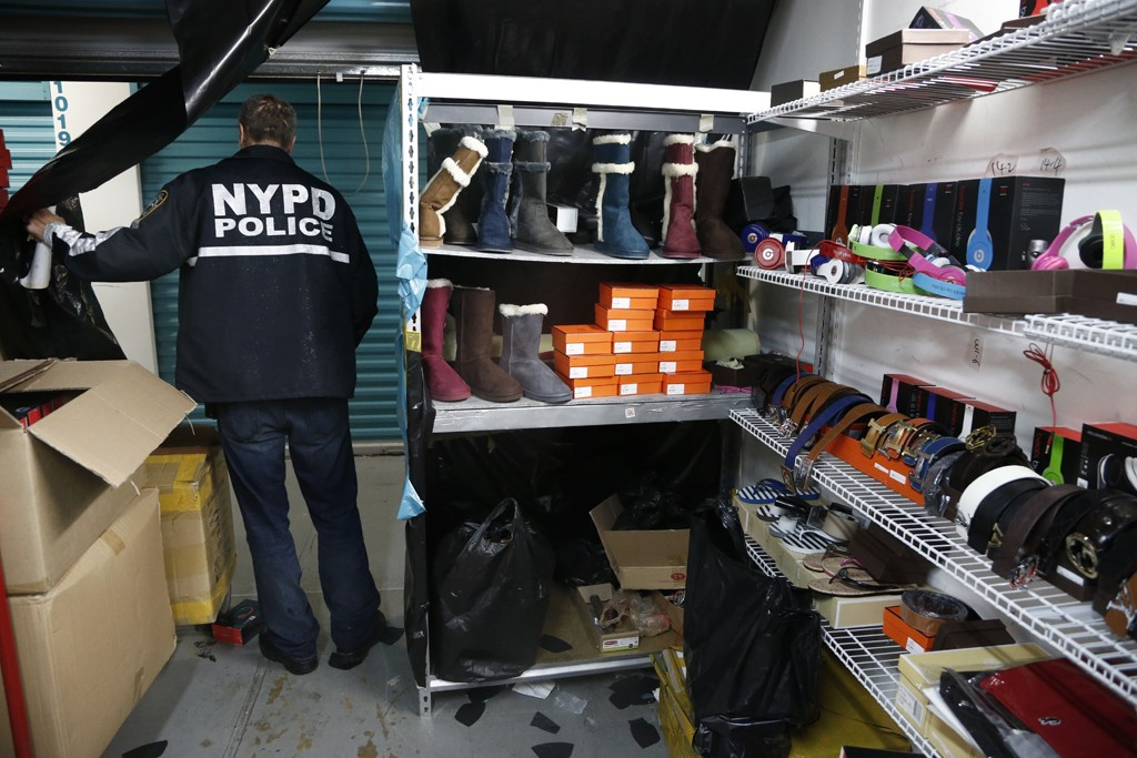 NYPD busted suspects in Queens, N.Y., who had kept piles of counterfeit goods in storage units.
