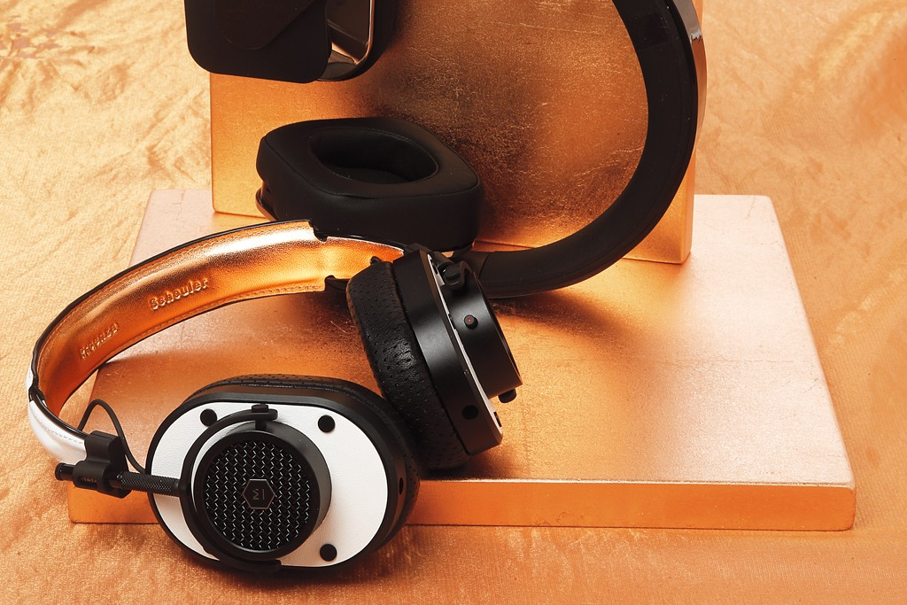Proenza Schouler by Master & Dynamic's goatskin, lambskin, aluminum and stainless steel headphones (bottom) and car-stereo-maker Alpine's silicone-and-plastic headphones.