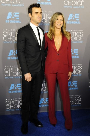 Justin Theroux in Dior Homme with Jennifer Aniston in Gucci and Christian Louboutin.