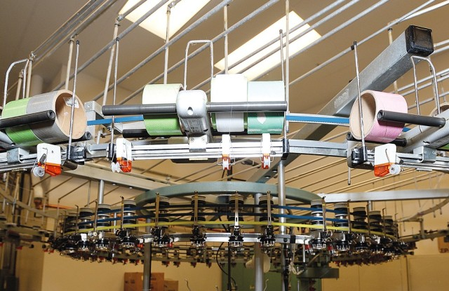 One of several circular knitting machines used for product development.