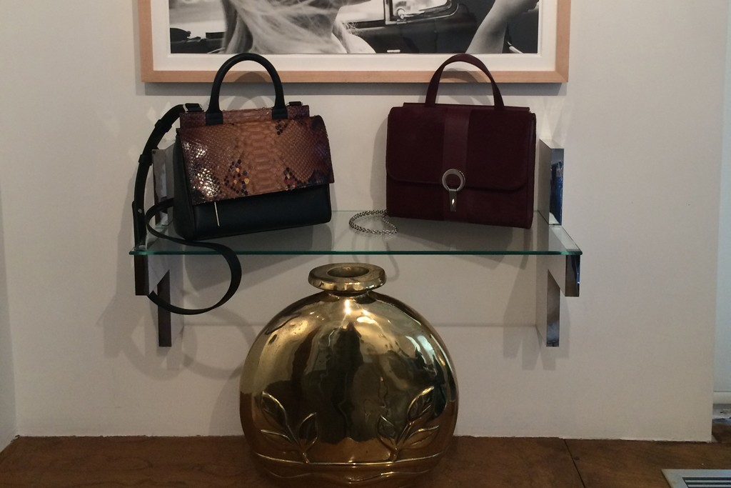 Marin Hopper of Hayward has recently relocated both her family and business back to New York City where she produces and sells the her bags. Pictured here under grandfather Leland Hayward's image of Tippi Hedren is the Mini Kit and the Violet bag.