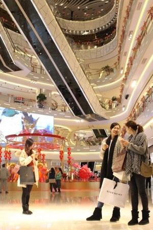 Shoppers inside Shanghai's IAPM mall.